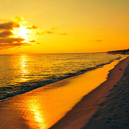 golden sunset sea red orange black beach gold clouds romantic real UGC travel content photography